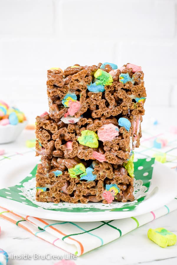 Lucky Charms Marshmallow Treats - these magically delicious cereal bars are loaded with lots of bright colored marshmallows! Make this easy recipe for lunch boxes or after school snacks! #nobaketreats #luckycharms #cerealbars #luckycharmstreats #stpatricksday