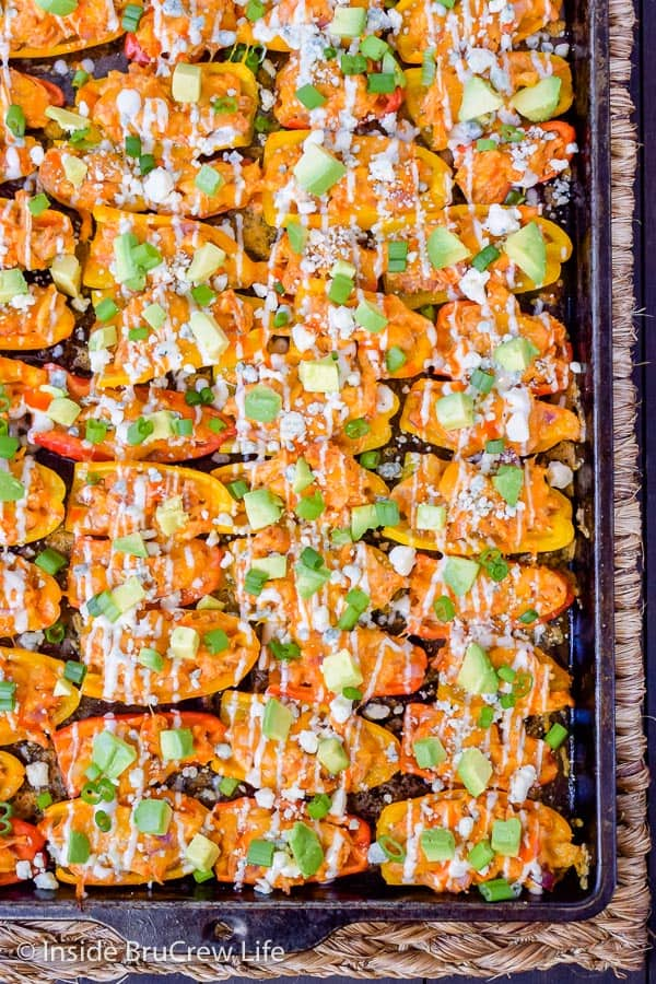 Buffalo Chicken Pepper Nachos - mini peppers filled with buffalo chicken and cheese is a delicious low carb appetizer. Easy sheet pan recipe to make for game day parties or dinner! #buffalochicken #lowcarb #appetizer #healthy #sheetpanmeal