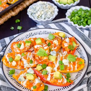 Buffalo Chicken Pepper Nachos - this easy low carb appetizer is filled with buffalo chicken and cheese. Easy recipe to make for game day parties or dinner! #buffalochicken #lowcarb #appetizer #healthy #sheetpanmeal