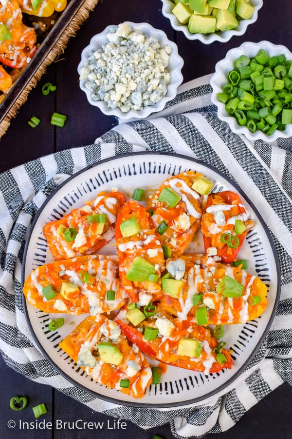 Buffalo Chicken Pepper Nachos - easy low carb appetizer using mini peppers and buffalo chicken. Great low carb meal for game days or parties! #buffalochicken #lowcarb #appetizer #healthy #sheetpanmeal