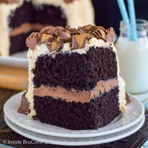 A slice of chocolate peanut butter cake on a white plate.