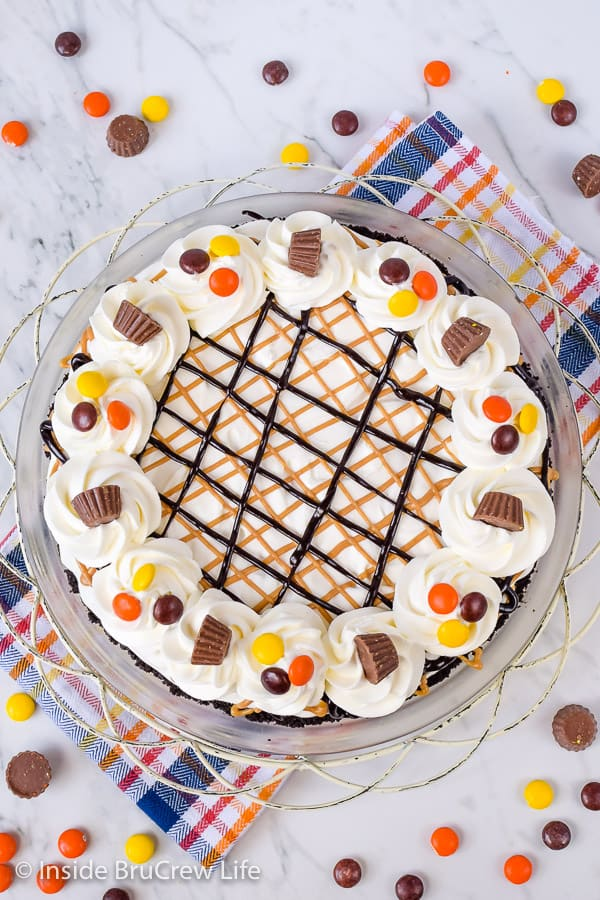 Chocolate Peanut Butter Pie - this no bake pie has layers of peanut butter cheesecake and chocolate pudding. It will disappear in a hurry when you make it for dessert! #pie #peanutbutter #chocolate #nobake #pieday #chocolatepeanutbutter #reeses