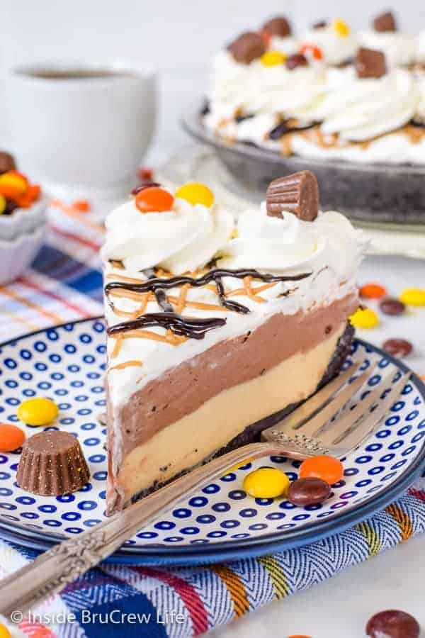 Chocolate Peanut Butter Pie - layers of creamy peanut butter cheesecake and chocolate pudding make this no bake pie a hit with everyone. Make this easy recipe for dessert tonight! #pie #peanutbutter #chocolate #nobake #pieday #chocolatepeanutbutter #reeses