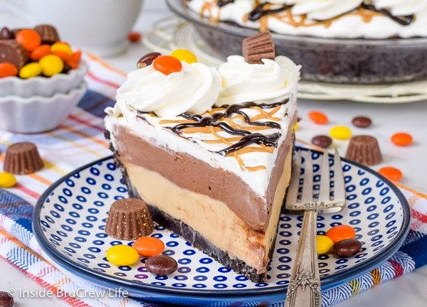 A slice of Peanut Butter Pie with layers of chocolate pudding and Cool Whip on top