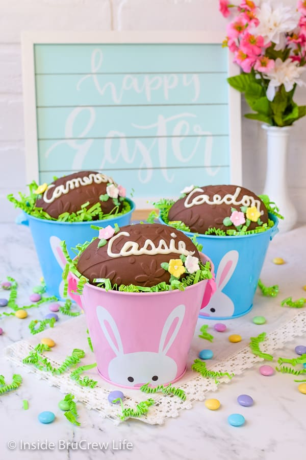 Decorated Peanut Butter Eggs - a smooth peanut butter filling covered in dark chocolate is a delicious treat. Adding candy flowers and a name makes them perfect for personalizing Easter baskets. #easter #peanutbutter #chocolate #nobake #homemade #eggs
