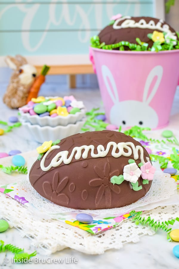 Decorated Peanut Butter Eggs - candy flowers and a name gives these homemade peanut butter eggs a fun flair. Make this no bake recipe for Easter baskets. #easter #peanutbutter #chocolate #nobake #homemade #eggs