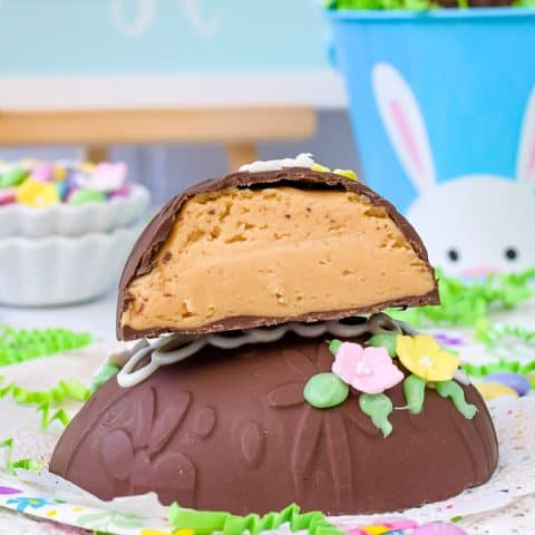 Decorated Peanut Butter Eggs - these giant homemade peanut butter eggs are covered in dark chocolate and decorated with a name and candy flowers. Make these fun treats for Easter baskets. #easter #peanutbutter #chocolate #nobake #homemade #eggs