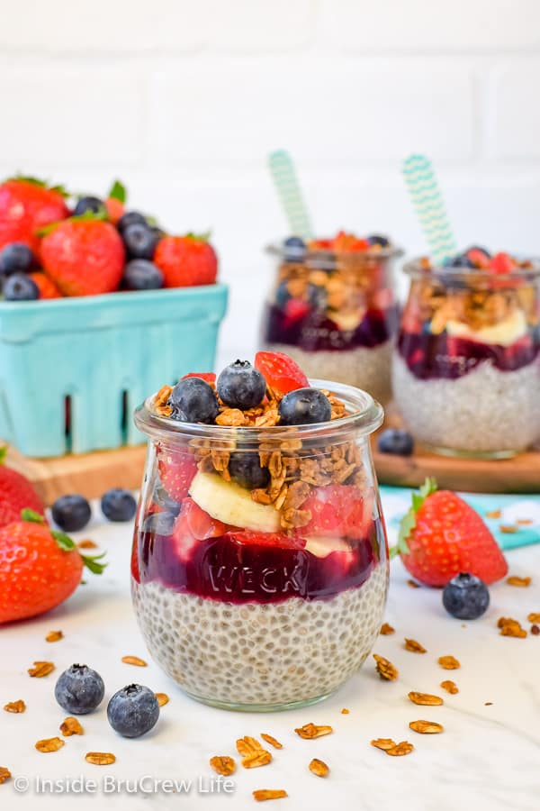 Chia Seed Pudding Parfaits - layers of creamy chia pudding, preserves, fruit, and granola makes a healthy and filling treat. Make this easy recipe for a quick and easy breakfast for the week. #chiapudding #healthy #pudding #fruitparfaits