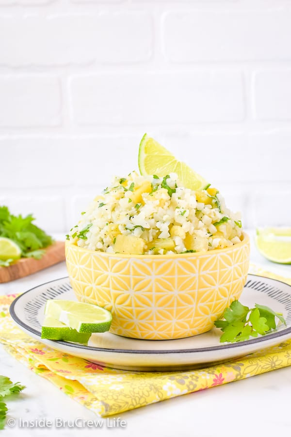 Pineapple Lime Cauliflower Rice - lime juice and pineapple chunks give this cauliflower rice a great tropical flavor. Try this easy recipe with fish, tacos, or grilled chicken dinners. #healthy #cauliflower #pineapple #rice