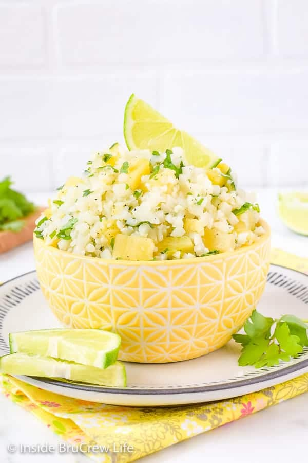Pineapple Lime Cauliflower Rice - a bowl of this easy cauliflower rice gets it's flavor from pineapple, lime, and cilantro. Make this easy and healthy recipe to go with tacos, fajitas, fish, or grilled chicken. #healthy #cauliflower #pineapple #rice