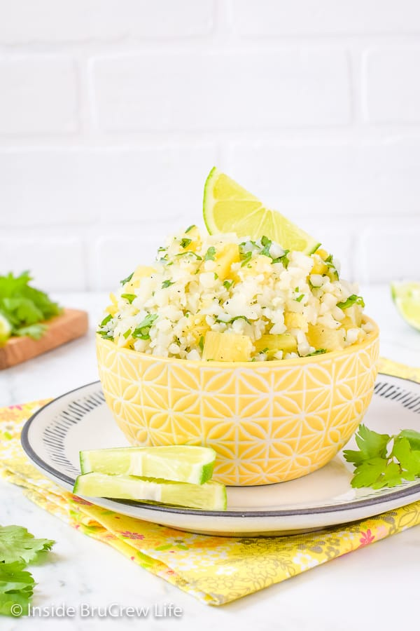 Pineapple Lime Cauliflower Rice - adding pineapple and lime gives this easy cauliflower rice a sweet and tropical flavor. Enjoy it with tacos, fish, or grilled chicken! #healthy #cauliflower #pineapple #rice