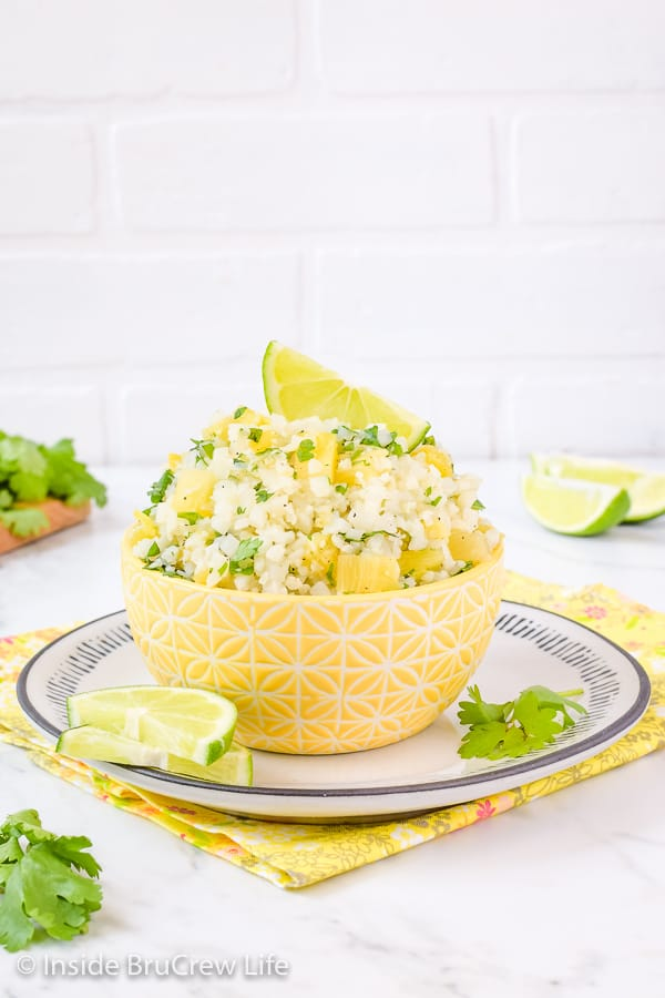 Pineapple Lime Cauliflower Rice - adding pineapple and lime to a bowl of easy cauliflower rice adds a delicious tropical flavor. Make this healthy recipe to enjoy with fish, tacos, or grilled chicken dinners! #healthy #cauliflower #pineapple #rice
