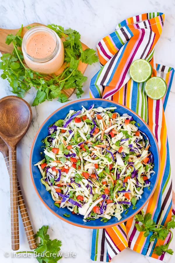 Sweet and Spicy Coleslaw - a Sriracha and honey dressing gives this easy coleslaw a great sweet and spicy flavor. Try this easy recipe for pork or fish dinners! #coleslaw #sweetandspicy #sriracha #honey #summer #potluck