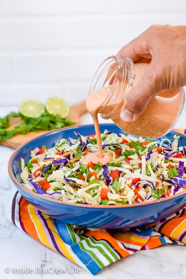 Sweet and Spicy Coleslaw - this easy coleslaw has a great sweet and spicy flavor from the honey and Sriracha dressing. Make this easy recipe to serve with pork or fish dinners! #coleslaw #sweetandspicy #sriracha #honey #summer #potluck