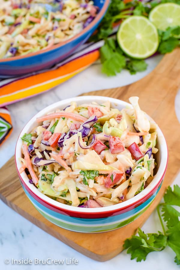 Sweet and Spicy Coleslaw - this easy coleslaw recipe comes together in minutes. Honey and Sriracha give it a great sweet and spicy flavor. #coleslaw #sweetandspicy #sriracha #honey #summer #potluck