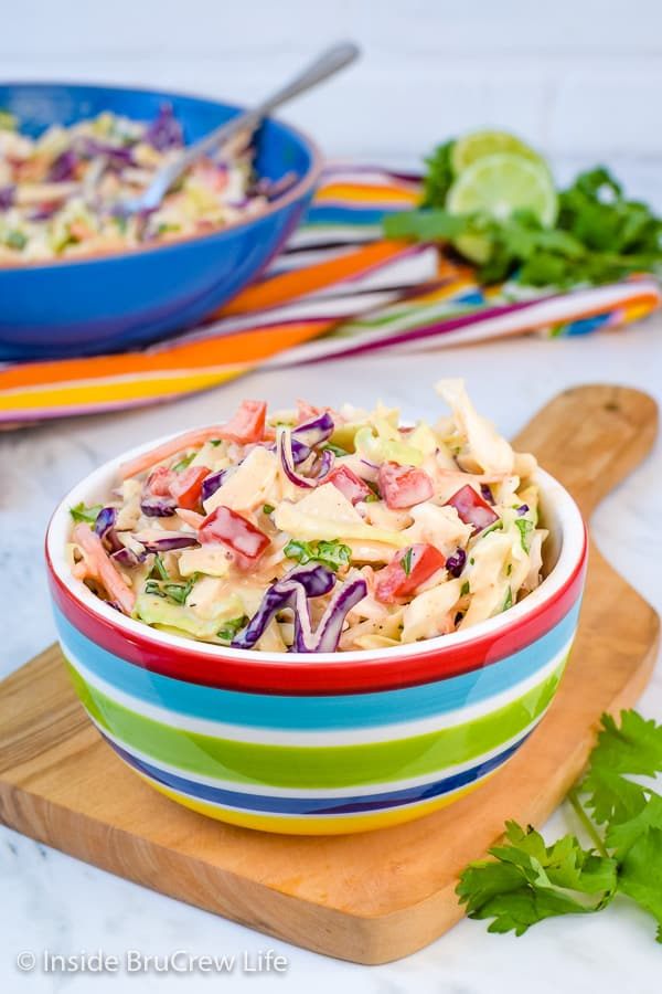 Sweet and Spicy Coleslaw - this easy coleslaw gets the sweet and spicy flair from honey and Sriracha. It's the perfect side dish for any pork or fish dinner. #coleslaw #sweetandspicy #sriracha #honey #summer #potluck