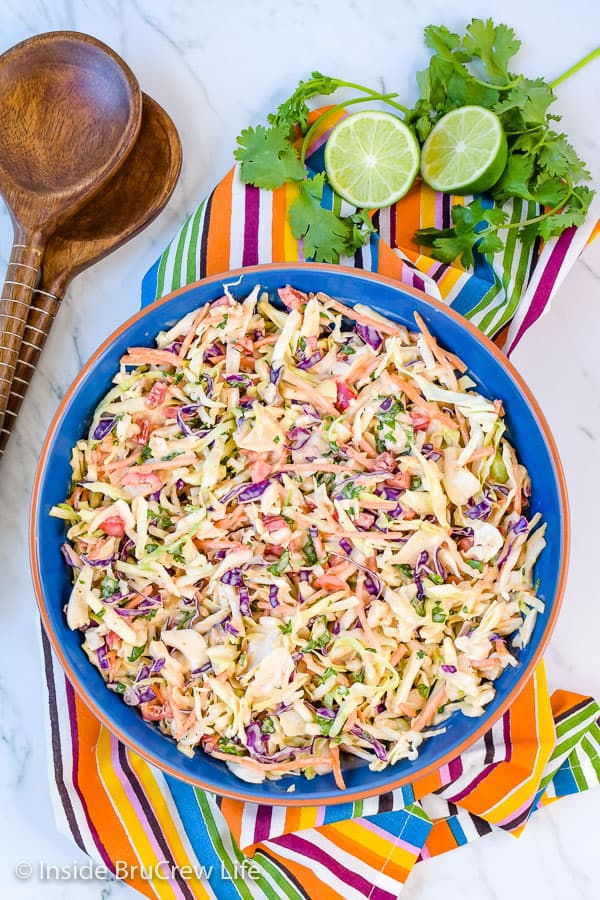 Sweet and Spicy Coleslaw - a bowl of this easy coleslaw is the perfect addition to pork or fish dinners. The sweet and spicy dressing adds a great flavor. #coleslaw #sweetandspicy #sriracha #honey #summer #potluck