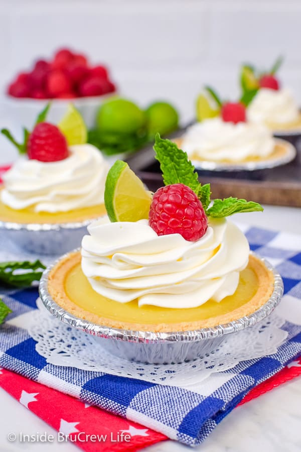 No Bake Mini Key Lime Pies - fresh berries, whipped cream, and key lime curd make these little pies the perfect summer dessert! #nobake #keylime #keylimepie #easyrecipe #pie #keylimecurd