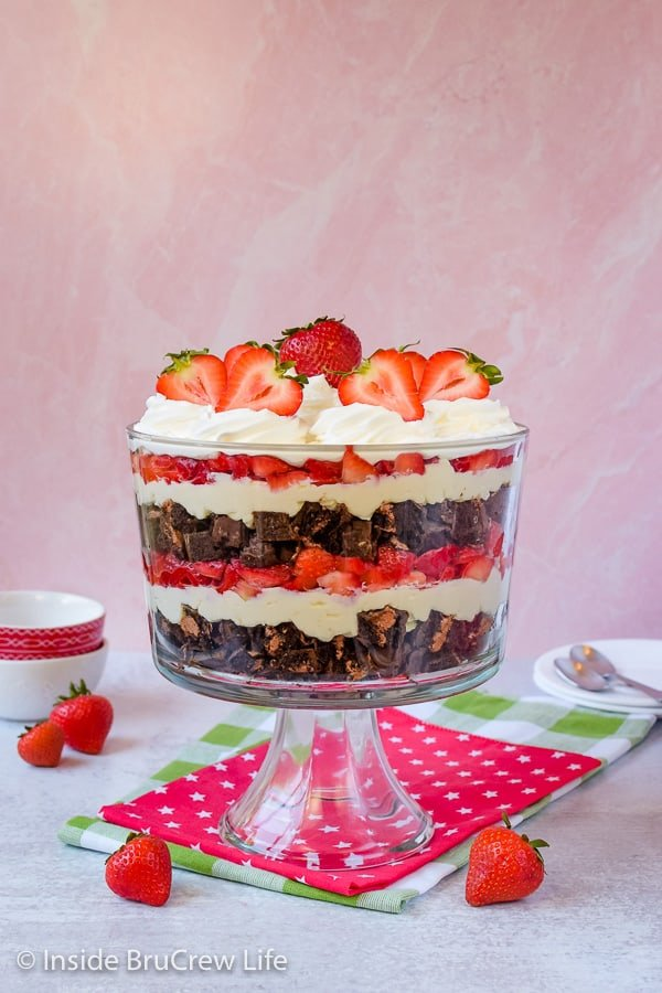 Easy No Bake Neapolitan Cheesecake Trifle - cake, cheesecake, and berries layered in a large bowl is the perfect dessert to make when it is too hot to bake! Easy recipe for summer parties! #caketrifle #nobakedessert #neapolitan #chocolate #strawberry #nobakecheesecake