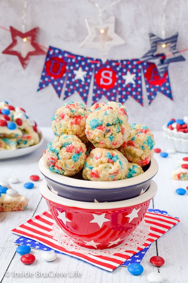 A star bowl filled with round red white and blue rice krispie treats