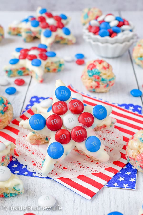 Rice krispie treat stars decorated with red white and blue M&Ms on a white board