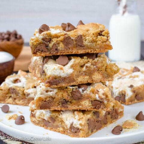 A stack of s'mores bars on a white plate.