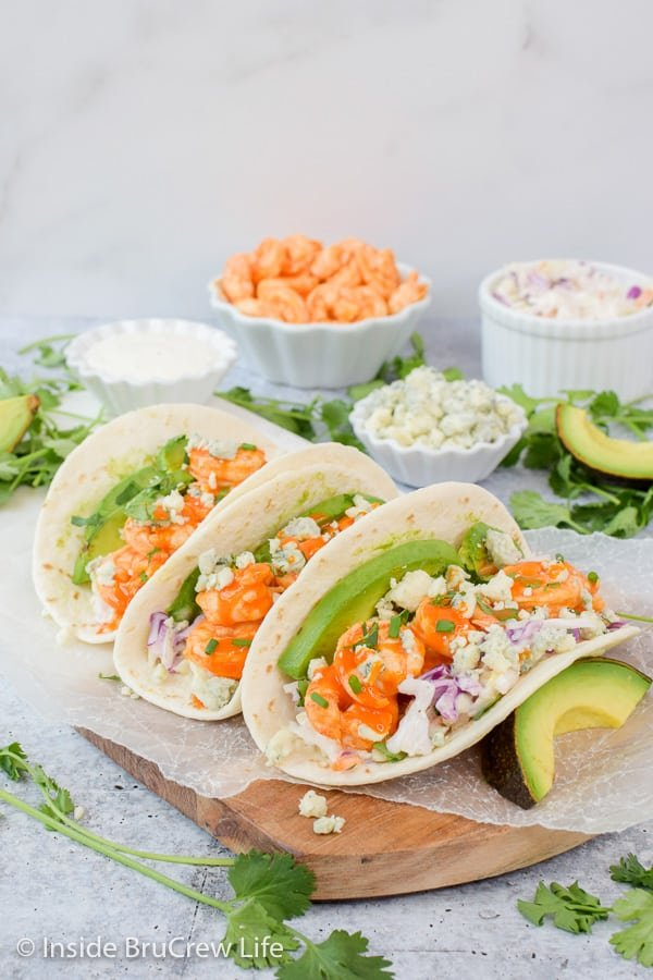 Easy Buffalo Shrimp Tacos - tortillas stuffed with toppings and buffalo shrimp can be on the table in less than 30 minutes. Try this easy recipe on busy nights! #tacos #buffaloshrimp #shrimptacos #tacotuesday