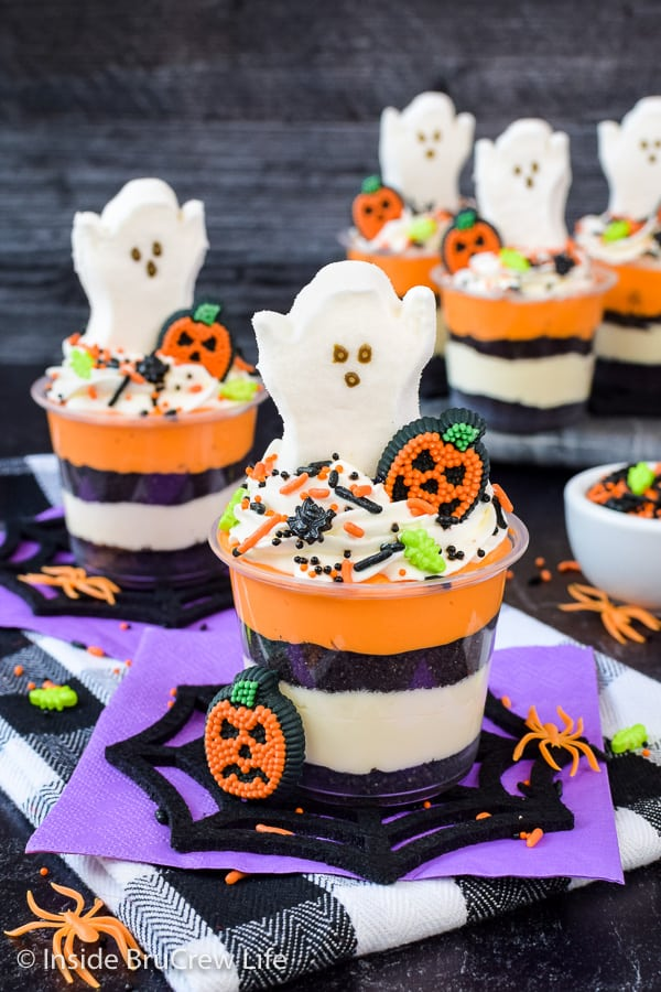 No Bake Halloween Cheesecake Parfaits - sprinkles and ghost Peeps make these easy cheesecake parfaits a fun treat to share at Halloween parties! #nobake #cheesecakeparfaits #halloween #spookytreats