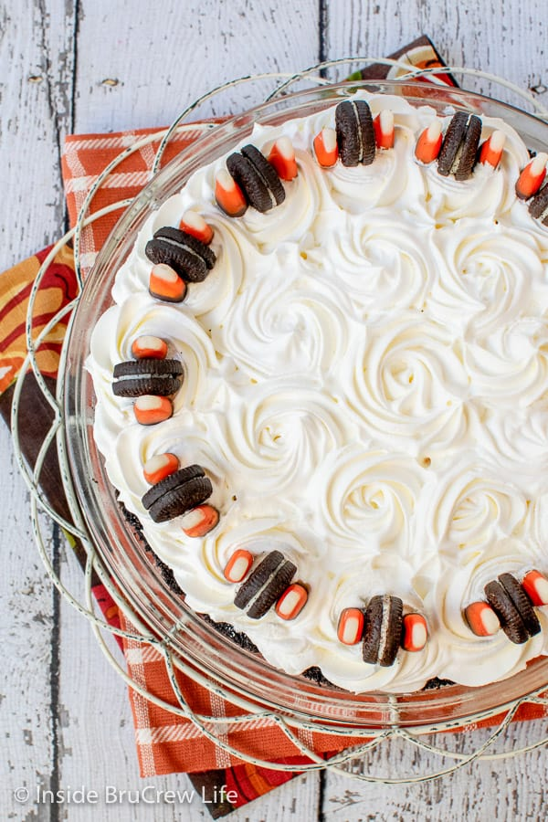 No Bake Halloween Oreo Cream Pie - this fun Halloween cream pie has four layers of striped dessert goodness. Try this easy recipe for Halloween parties.