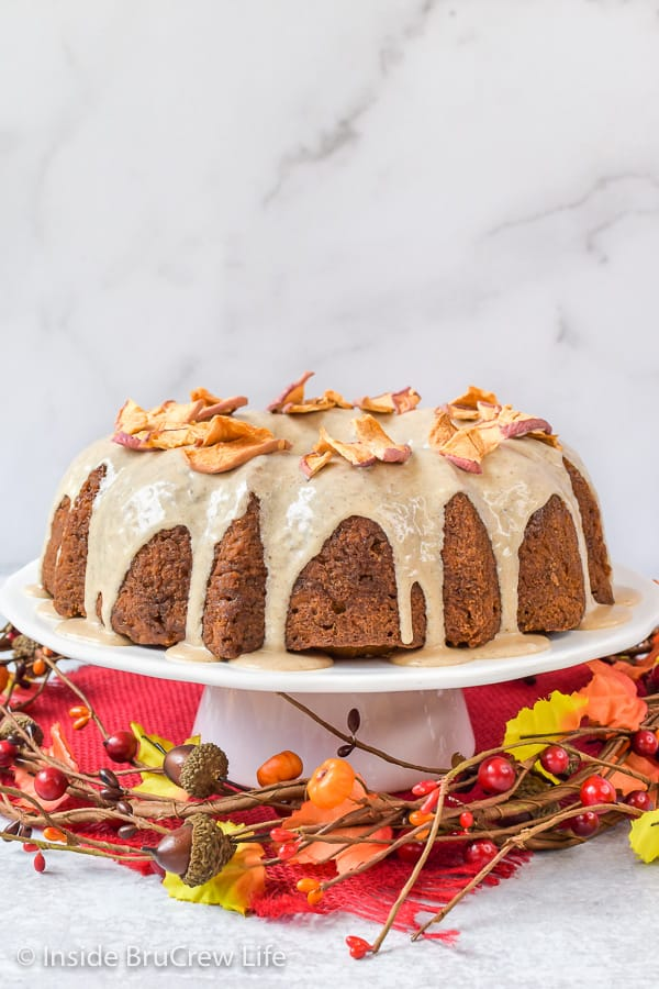 Toffee Apple Bundt Cake - shredded apples and toffee bits added to a homemade spice cake is the perfect fall dessert. Make this easy recipe for dessert or parties. #cake #bundtcake #apple #toffee #spicecake #homemade