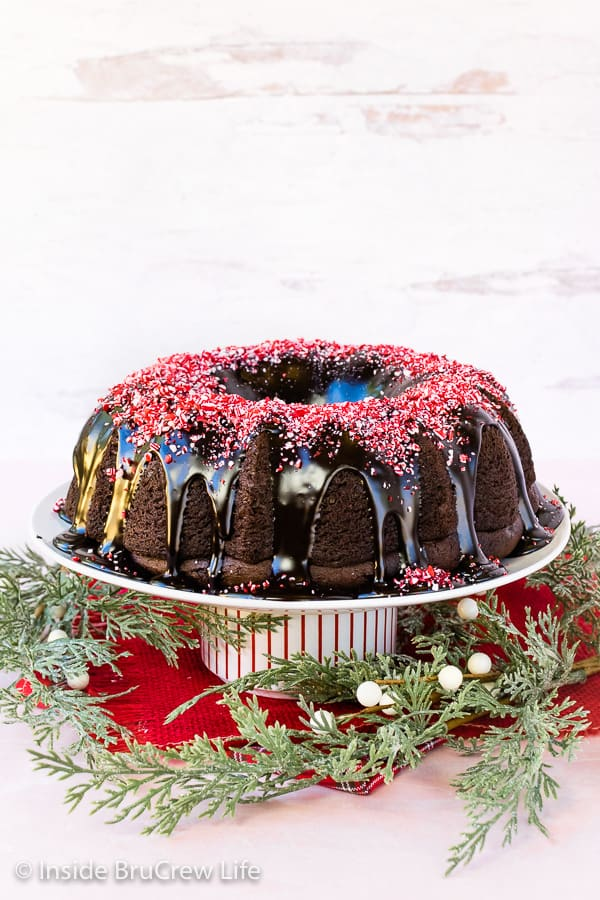 Peppermint Mocha Bundt Cake - a sweet espresso glaze and peppermint bits makes this easy chocolate bundt cake an impressive dessert. Make this easy recipe for holiday parties! #cake #bundtcake #chocolate #peppermint #peppermintmocha #holiday #christmas