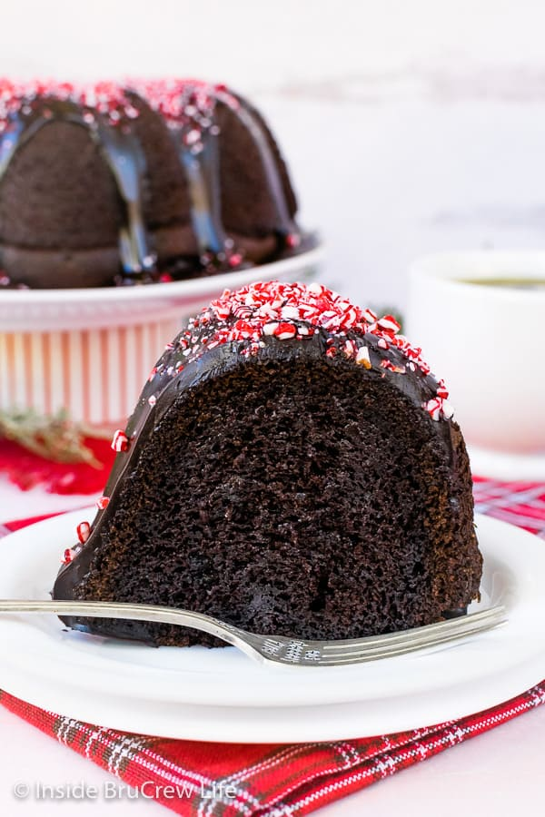 Peppermint Mocha Bundt Cake - peppermint bits and drizzles of mocha glaze add a fun and delicious flair to this easy holiday cake. #cake #bundtcake #chocolate #peppermint #peppermintmocha #holiday #christmas