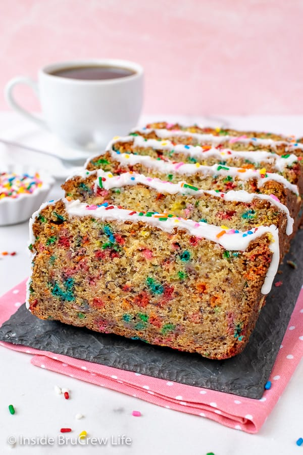 Funfetti Banana Bread - loads of colorful sprinkles and a sweet glaze make this sweet bread so fun to make and eat. Great recipe to use ripe bananas in. #banana #sweetbread #bananabread #funfetti #cakebatter #sprinkles