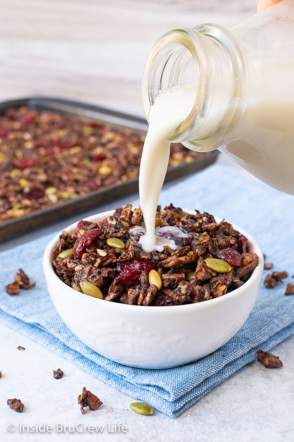 Salted Chocolate Grain Free Granola - this healthy homemade granola is loaded with nuts, coconut, and mix ins. Easy recipe to make for breakfast or after school snacks. #healthy #granola #grainfree #breakfast #homemade #glutenfree #vegan #dairyfree