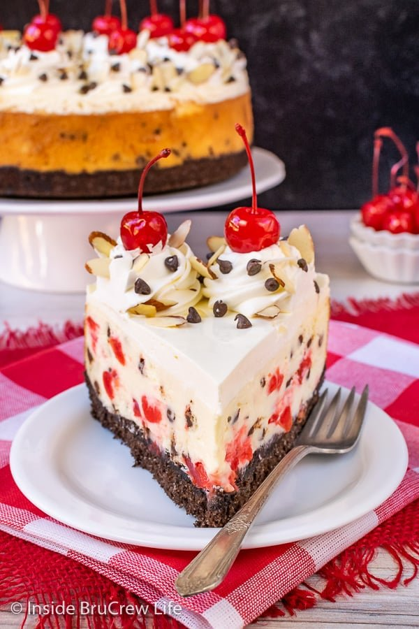 Almond Cherry Chip Cheesecake - chocolate chips and cherries make this almond cheesecake look and taste so good. Make this recipe for holidays or events. #cheesecake #almond #cherry #chocolatechip #valentinesday #holidaydessert #Christmas