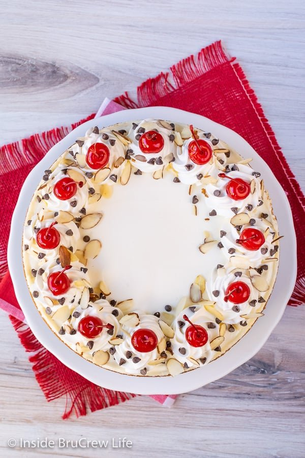 Almond Cherry Chip Cheesecake - this creamy almond cheesecake is studded with cherries and chocolate chips and looks so impressive. Easy recipe to make for holidays or events. #cheesecake #almond #cherry #chocolatechip #valentinesday #holidaydessert #Christmas