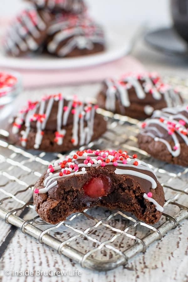 Chocolate Cherry Cookies - a hidden cherry under chocolate will make everyone smile when they bite into these easy chocolate cookies. Great recipe to make for Valentine's day or Christmas. #chocolate #cookies #cherry #chocolatecoveredcherries #cakemixcookies #valentinesday #christmas #cookieexchange