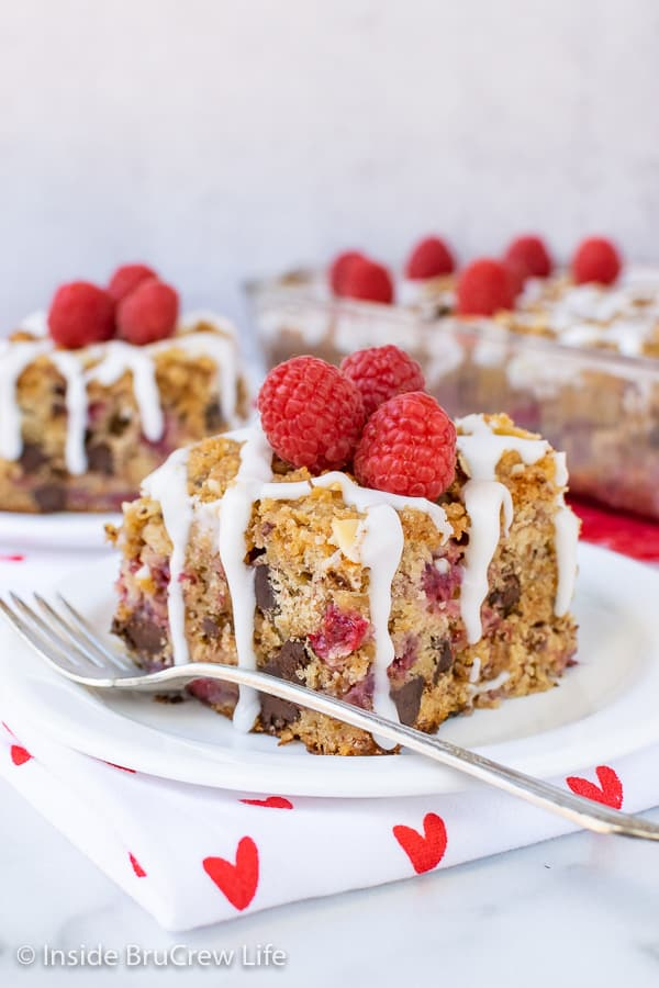 Chocolate Chip Raspberry Banana Coffee Cake - pockets of fruit, chocolate, and a buttery streusel makes this the best breakfast cake. Make this easy recipe to enjoy with a cup of coffee!