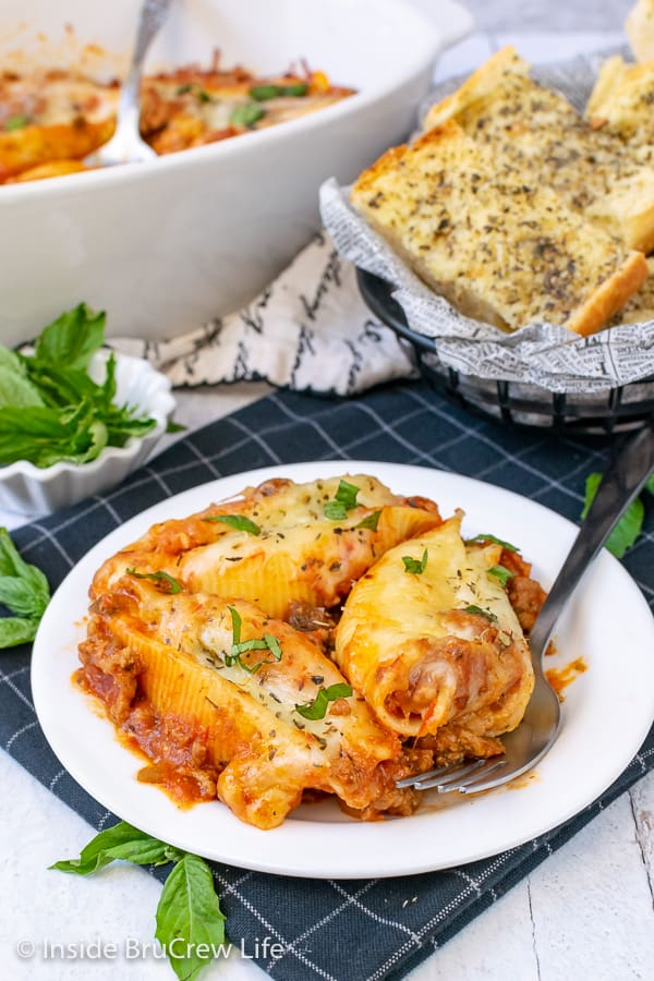 Classic Stuffed Shells - pasta shells stuffed with a three cheese filling is a delicious dinner to make in a hurry. Easy recipe to make now or freeze for later.