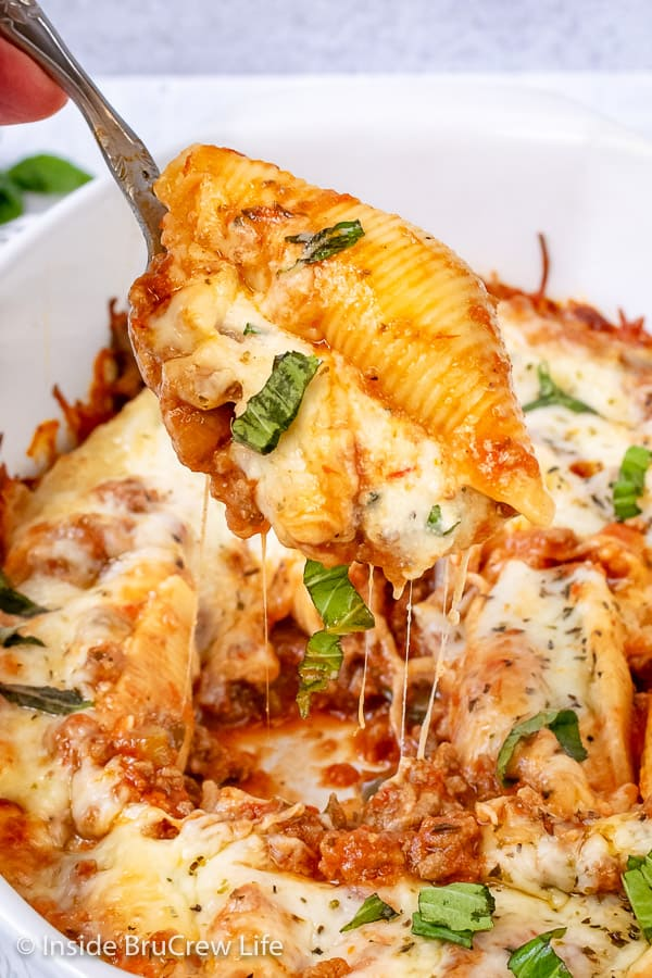 Classic Stuffed Shells - a creamy three cheese filling and meat sauce makes this comfort food taste amazing. Make this easy recipe for dinner or freeze for later.