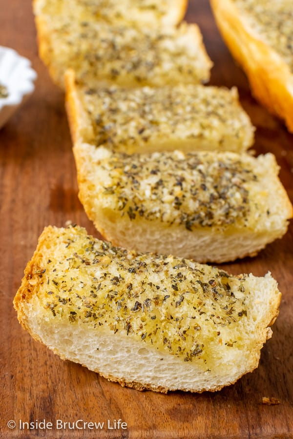 Easy Garlic Herb Bread - spread garlic herb butter all over the inside of a French bread loaf and bake until toasted. Make this easy recipe to enjoy with any dinner.