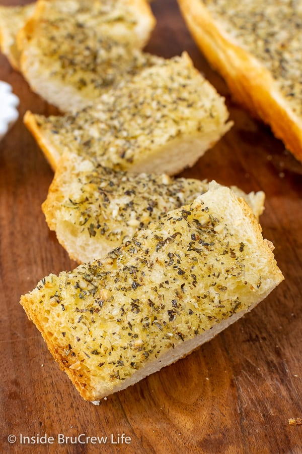 Easy Garlic Herb Bread - this easy garlic bread can be made right before dinner or frozen for later. The garlic butter makes this French bread taste so good.