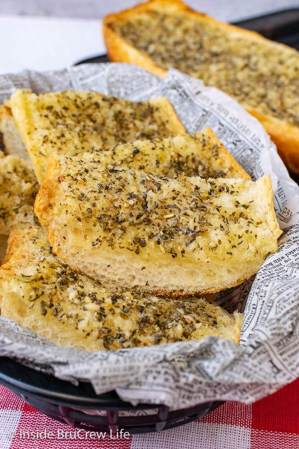 Easy Garlic Herb Bread - make your own garlic herb butter and spread it all over a loaf of French bread right before dinner. This easy and delicious recipe goes with everything.