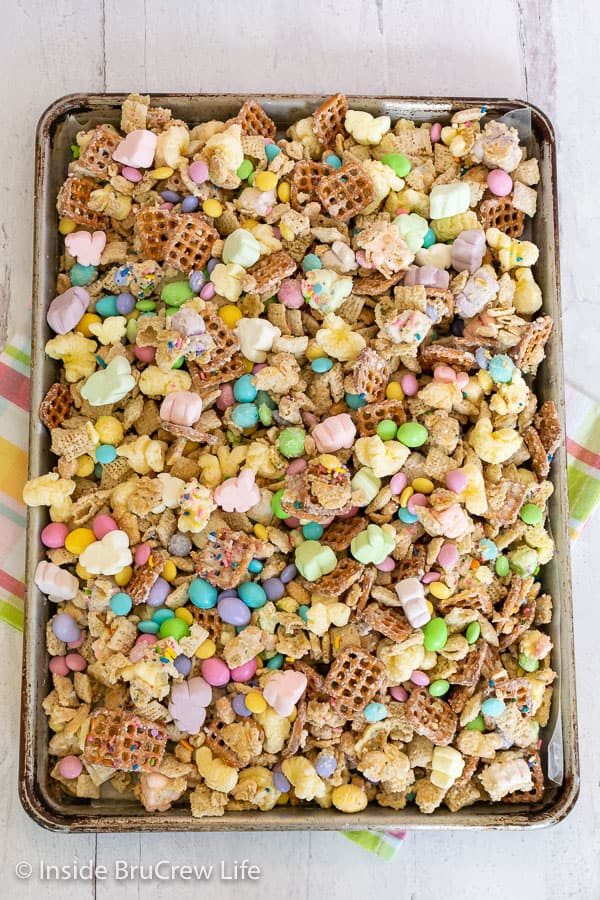 Overhead picture of a sheet pan filled with a colorful Easter snack mix
