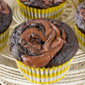 A chocolate banana muffins with Nutella swirls in top