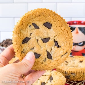 A giant Jack Jack Num Num Cookie held up in front of a white background