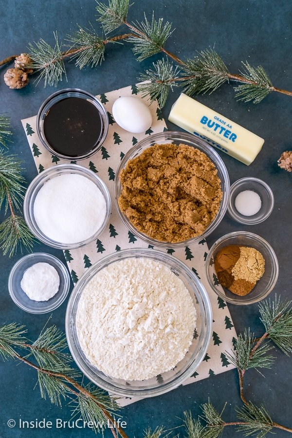 Overhead picture of the ingredients needed to make molasses crackle cookies on a blue background