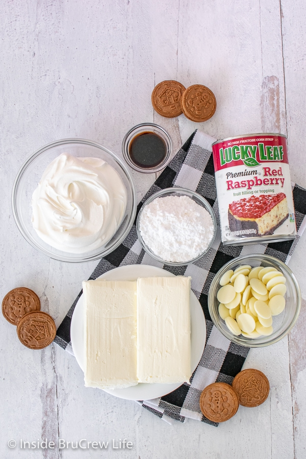 Overhead picture of ingredients needed to make raspberry white chocolate cheesecake parfaits