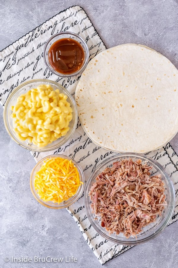 Overhead picture of all the ingredients needed to make a pulled pork macaroni and cheese tortilla wrap hack