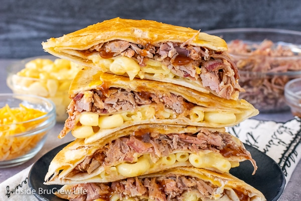 Pulled Pork Macaroni and Cheese Tortilla Wraps cut in half and stacked on top of each other showing the ingredients inside